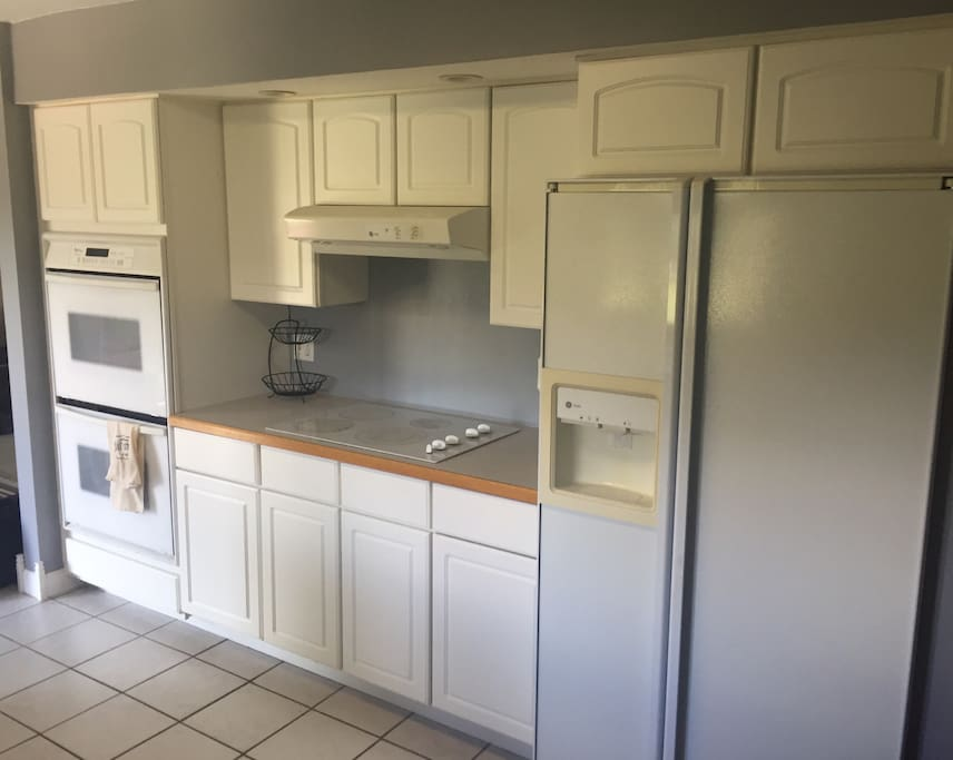 Electric stove top with double oven.