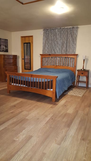 Comfortable Queen bed with Ikea bedding, dresser and walk in closet.