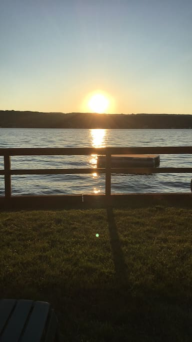 Beautiful setting sun on Keuka. Also a picture of the raft... Picture taken while relaxing in the chairs in the front yard!