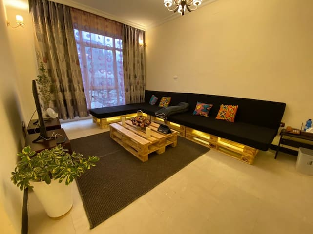 Our specious warm living room with comfortable L shaped couch