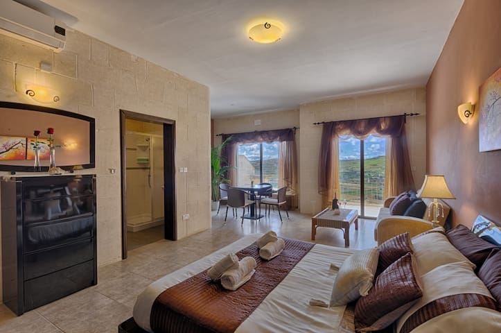 Deluxe King Suite with Ensuite Bathroom and Terrace with Country and Sea Views