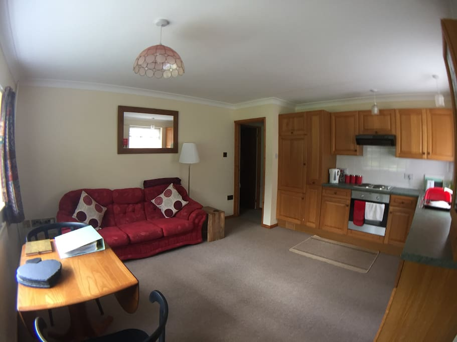 A lovely large lounge and kitchen area to relax in during your stay