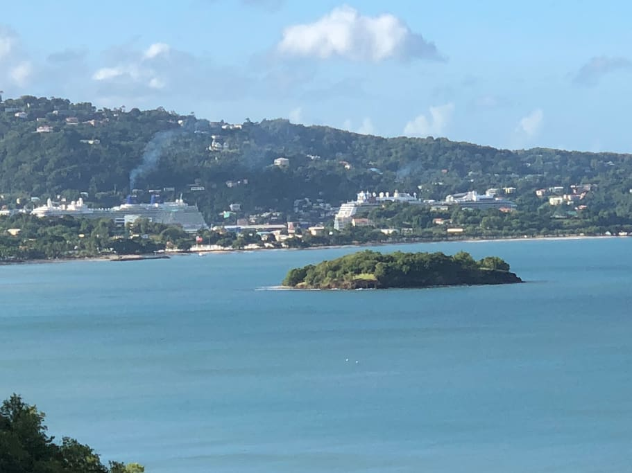 The view from your apartment.  Rat Island in the foreground and cruise ships in the Castries Harbour.
