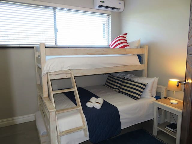 3rd Air-Conditioned Bedroom with a Tri-Bunk Bed (Double Bed at the bottom, Single bed on top, extra Single Bed below that is placed on the left hand side for a child)