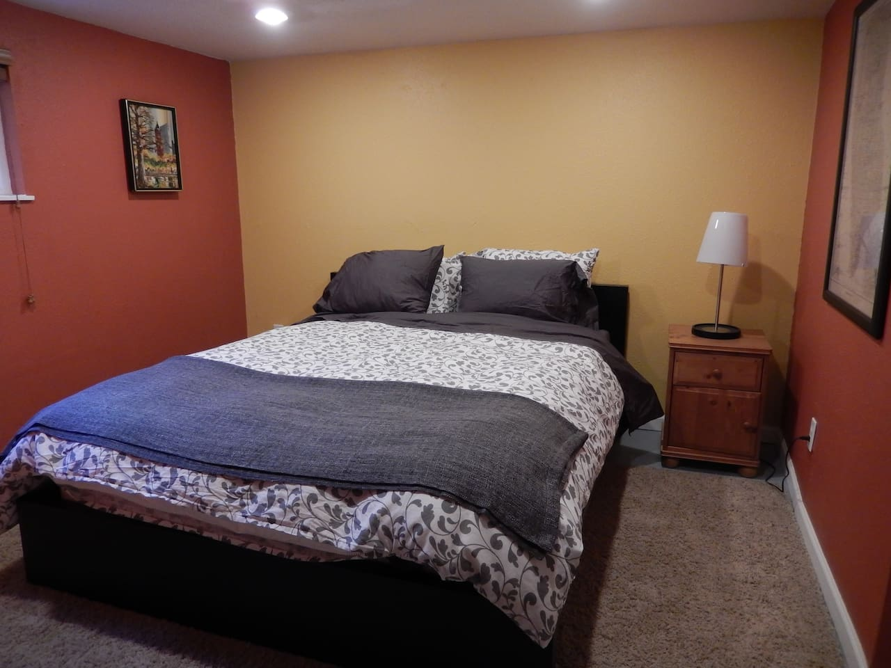 Cozy bedroom, located in the basement portion of the apartment.