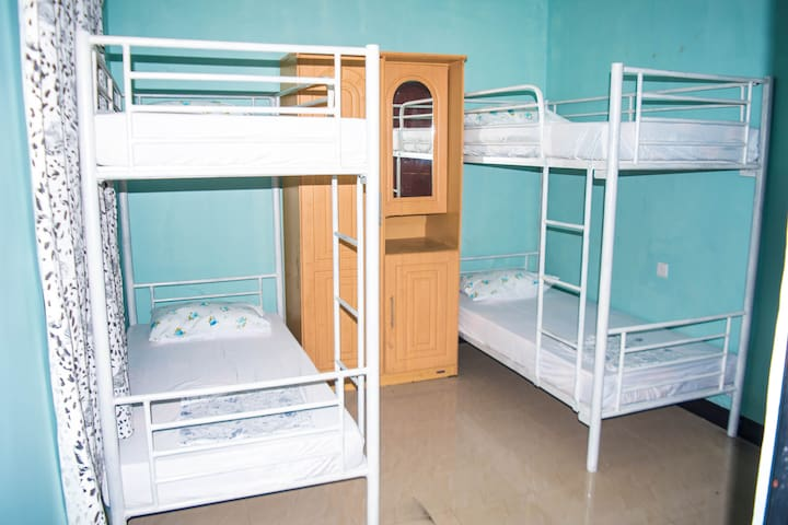 Bedroom with four beds