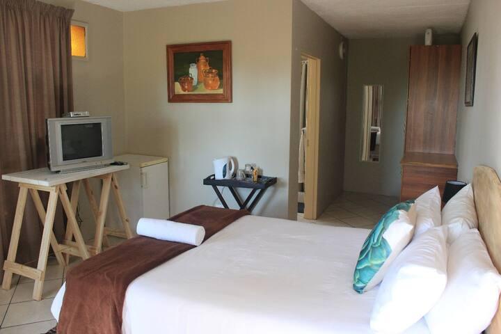 Room 1, double bed with en-suite bathroom, TV and fridge
