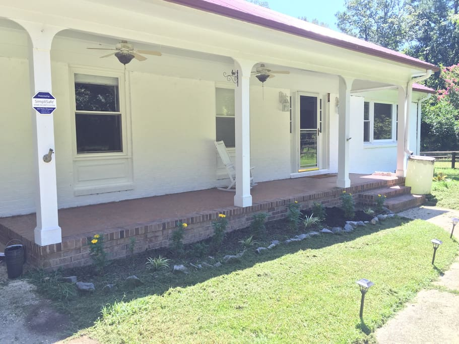Cute white farmhouse with lots of charm and character! Enjoy the fans on the front porch as you enjoy iced tea on the rocking chairs!