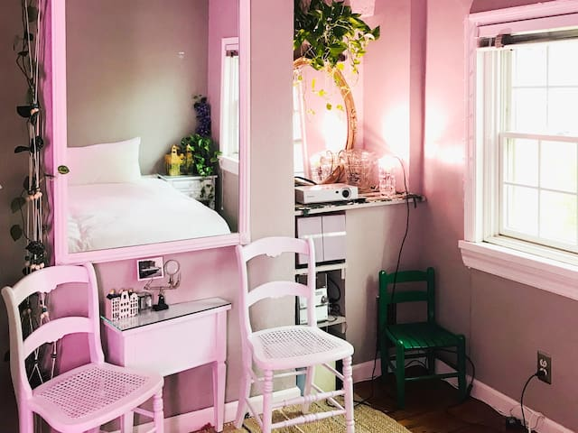 A cozy beautiful room with view of greens & birds