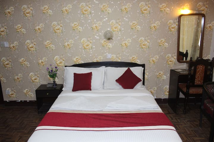 centrally located private sunny room