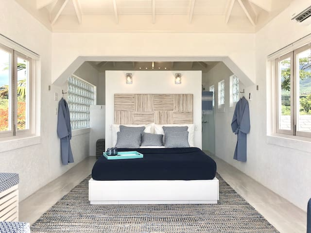 A very comfortable queen size bed at your disposal. The bed has drawers all under it for wardrobe space. You can see St.Kitts, the Caribbean Sea and the spectacular Sunsets from bed.