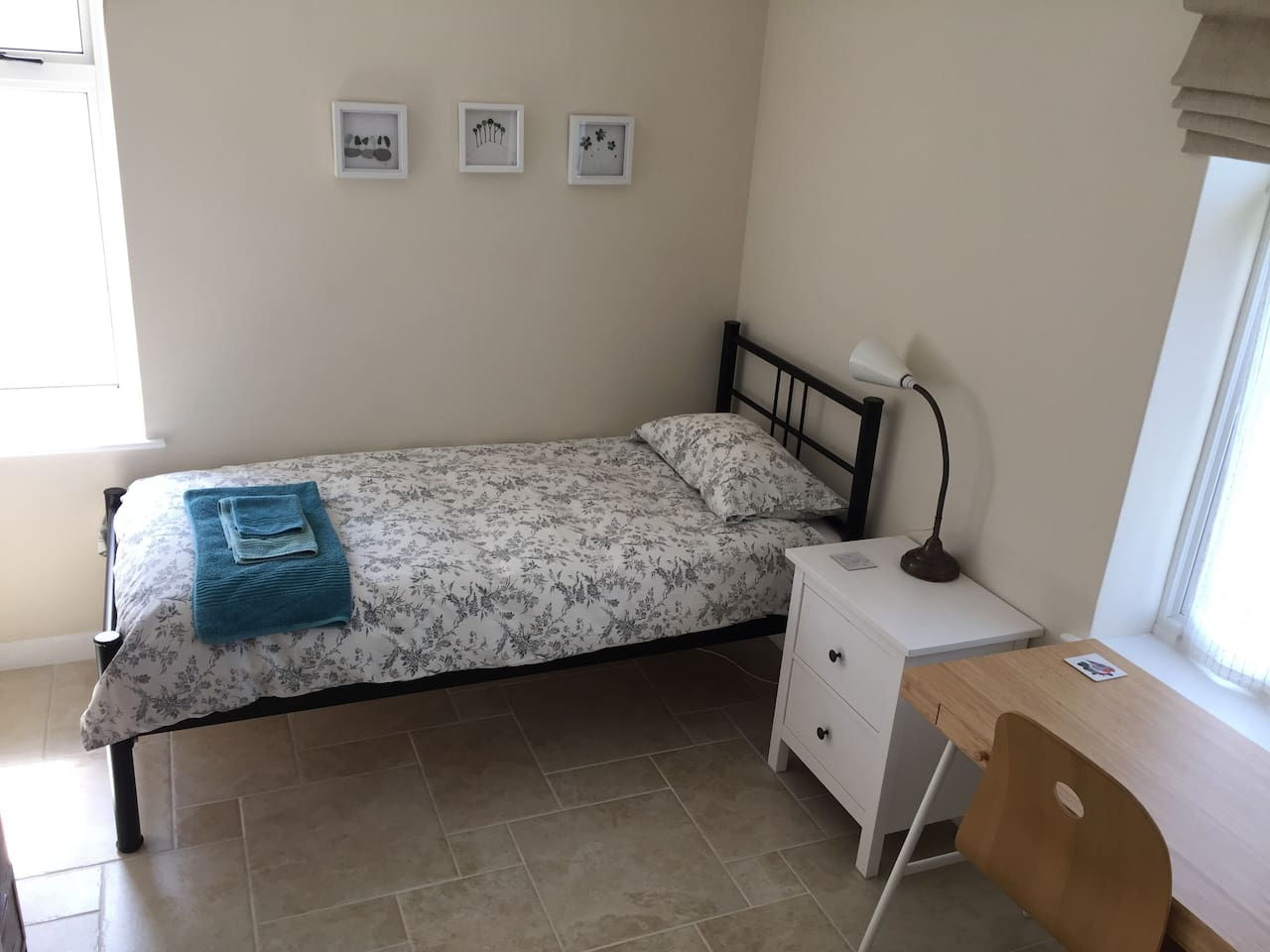 Spacious dual aspect light, modern and airy single room with comfortable bed, desk, wardrobe, drawers, full-length mirror and adjacent bathroom