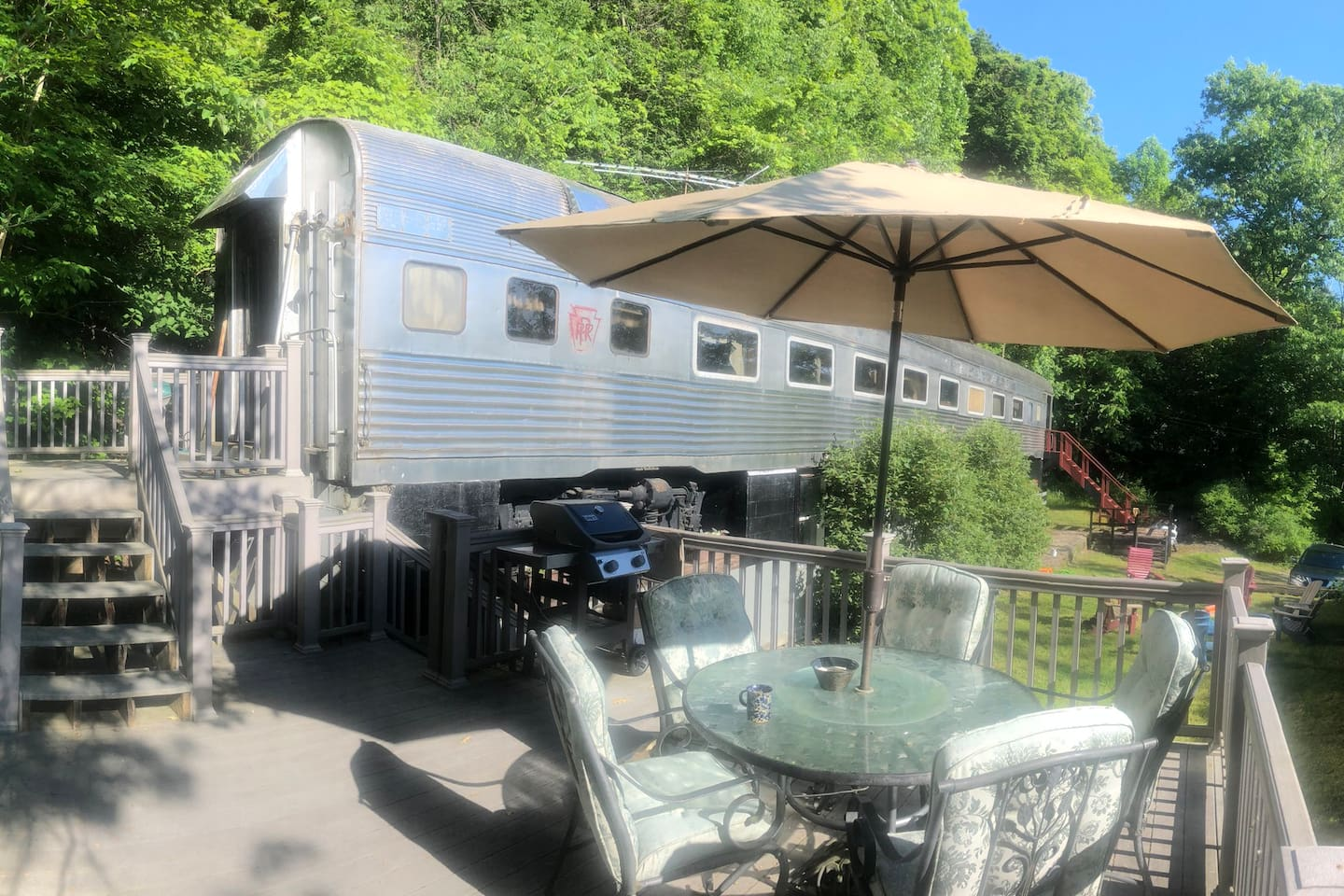 1930's stainless steel Railway Carriage set on the side of Beautiful Skaneateles Lake
