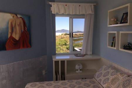 Private room right next to Santinho