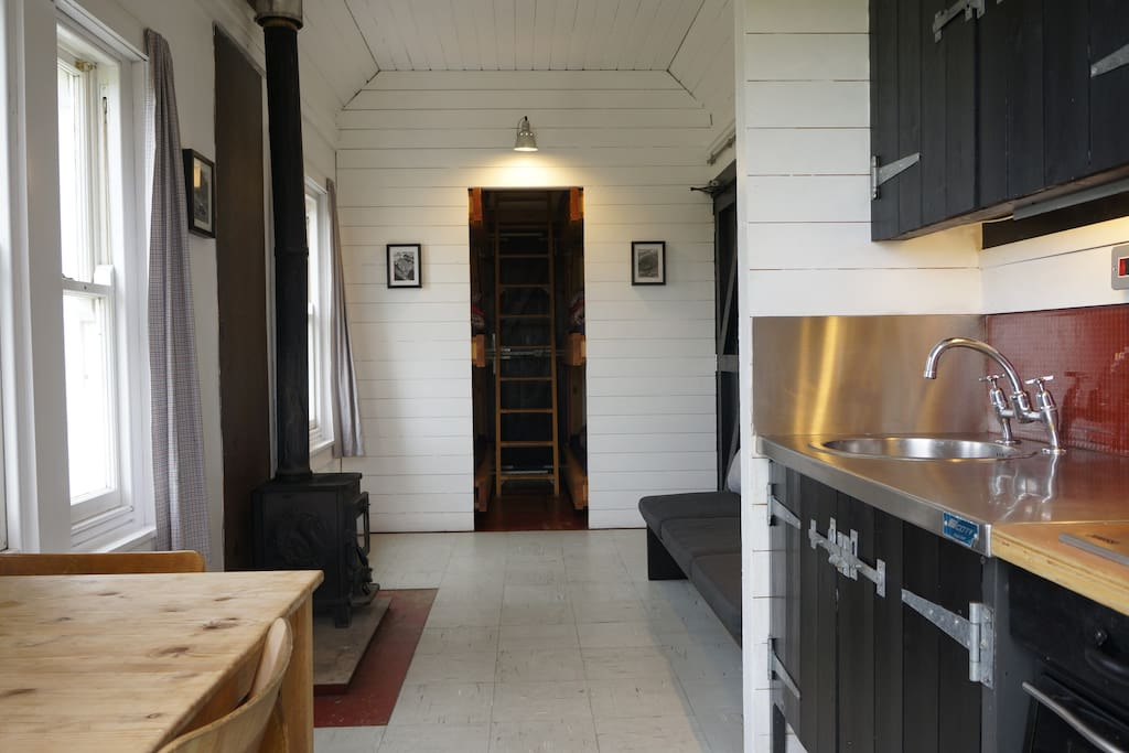 The inside is timber-lined with a great log burning stove. Sleeping area is at the far end - 3 bunks on each side.