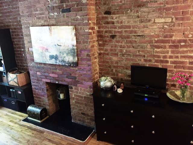 Exposed brick wall. Dresser for storage