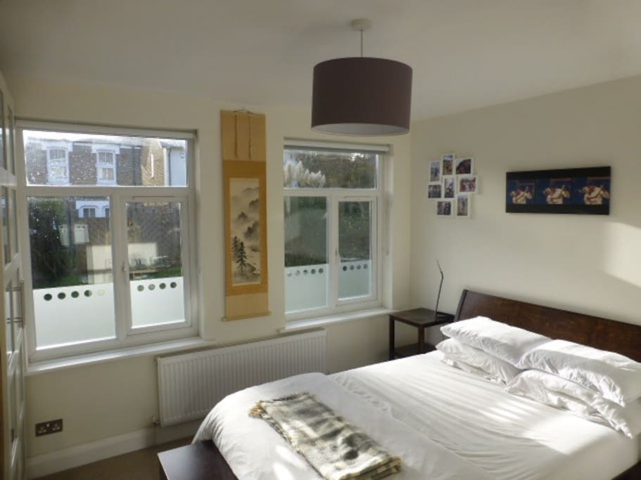 The master bedroom, full of natural light and lovely views on to our front garden!