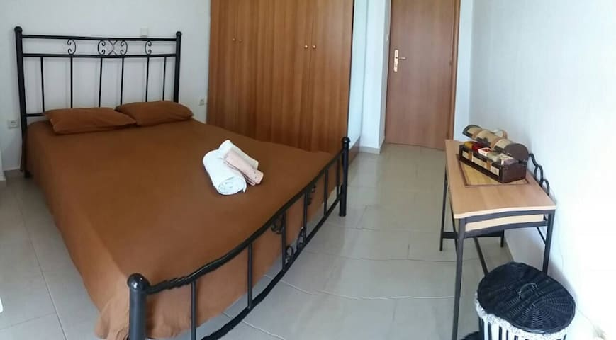 The first bedroom with the double bed, the big wardrobe and the front sea view balcony.