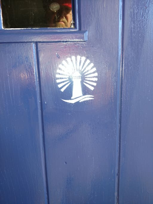 You know you're at the right house because of the distinctive blue front door and white logo.