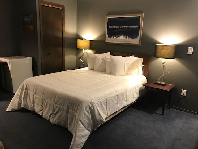 One queen bed with fresh linens changed with each stay.