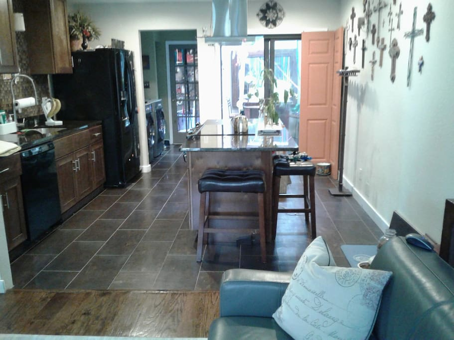 Kitchen, sunroom, and laundry.