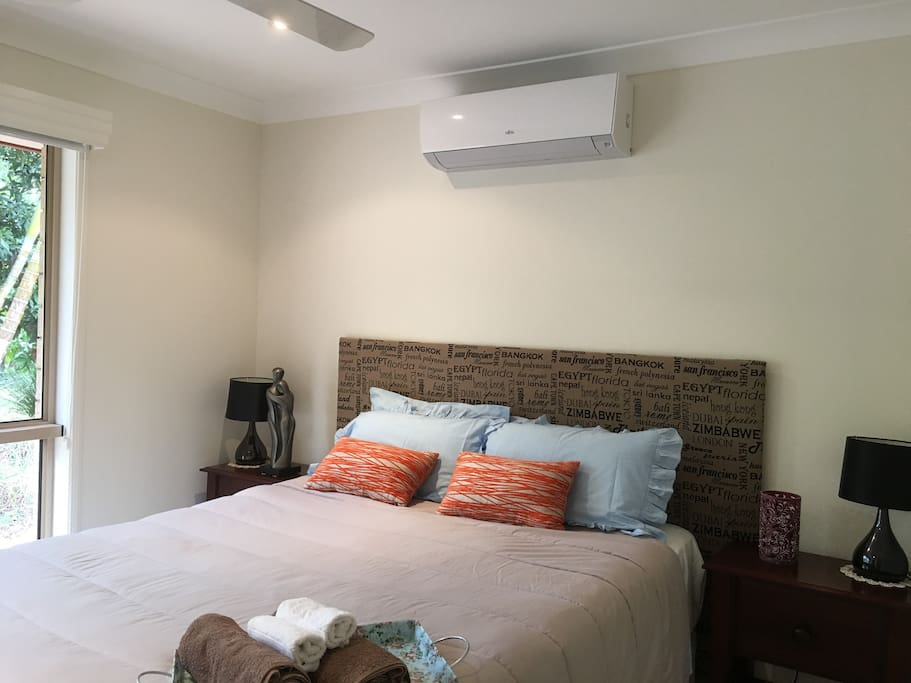 Queen Bedroom with Air Conditioning. Blinds, one for privacy and one for sleeping.