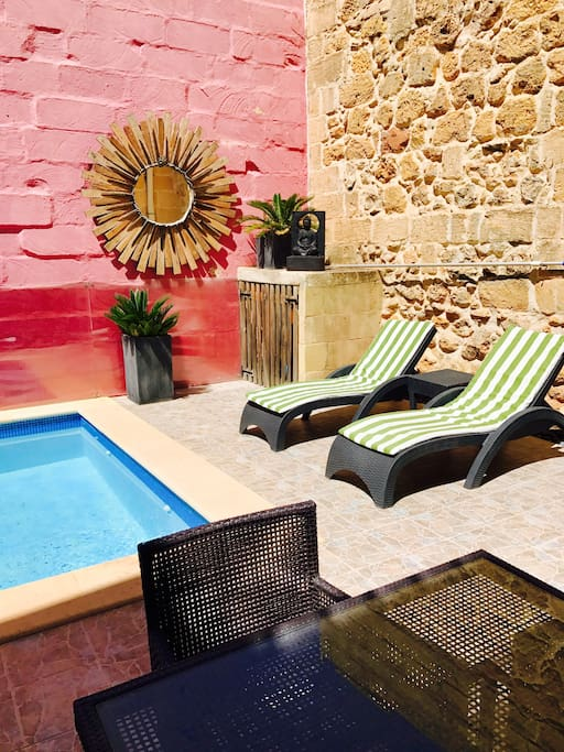 sunny private large pool with sun loungers and table with chairs