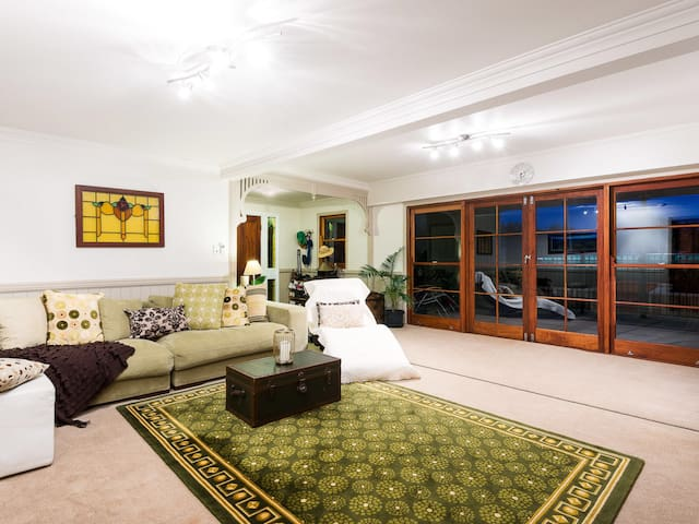 Family living room adjoining both bedrooms and leading out to the Terrace breakfast dining area.