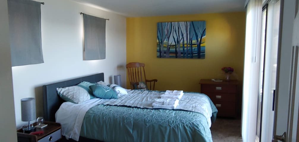 The Morning sunrise bedroom with sliding door to the balcony. Lamps have USB  slots to charge your phones.