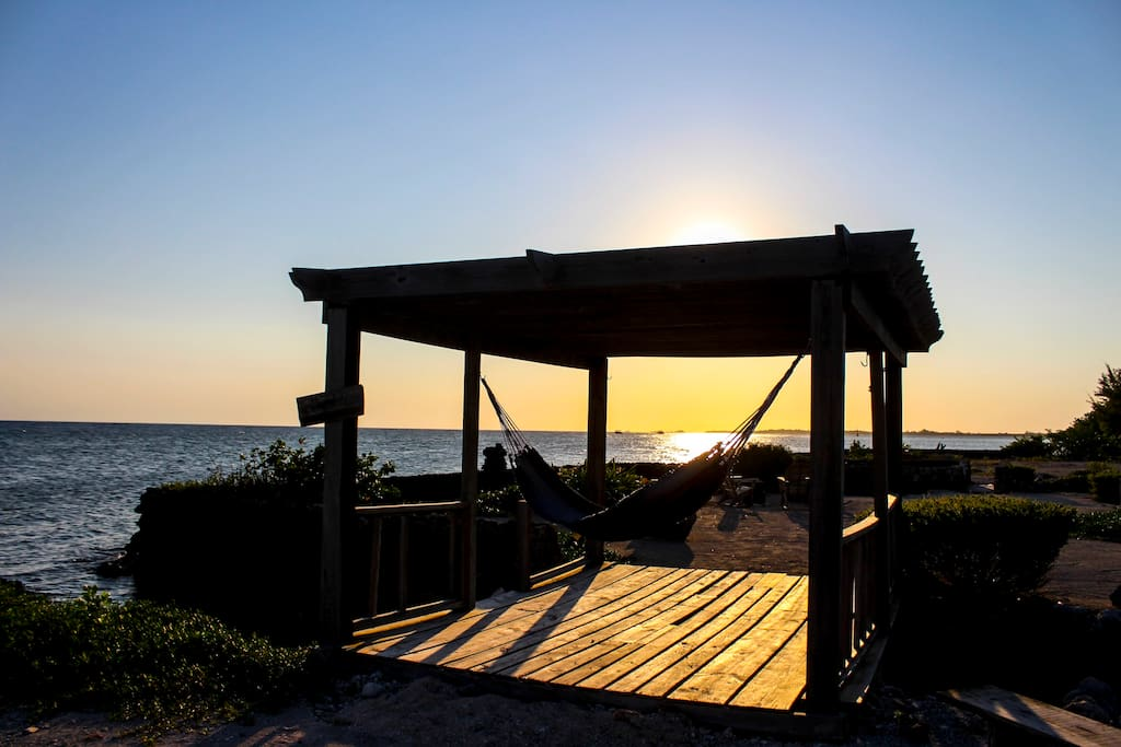 Lie in your own hammock, enjoy the breeze and watch the sun set.