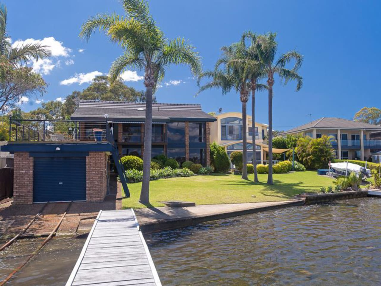 Architect designed luxury residence on a substantial level block with slipway, private deep water jetty and boat shed with a unique 20m deck above to soak in the spectacular views
