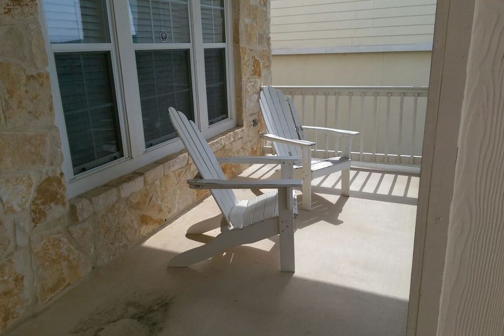 Nice covered front porch with chairs to enjoy a lovely day