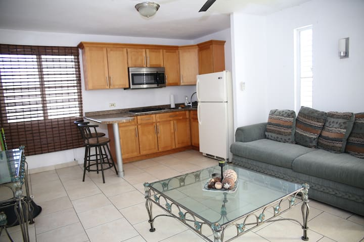 Spacius living Room and a Fully Equipped Kitchen