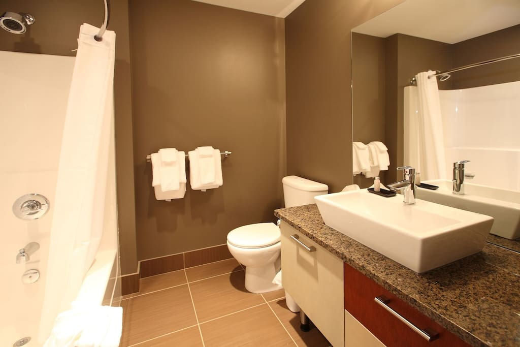 Get ready for the day in the modern and spacious bathroom.