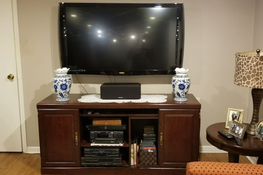 A flat-screen TV with Cable and an entertainment system for your enjoyment