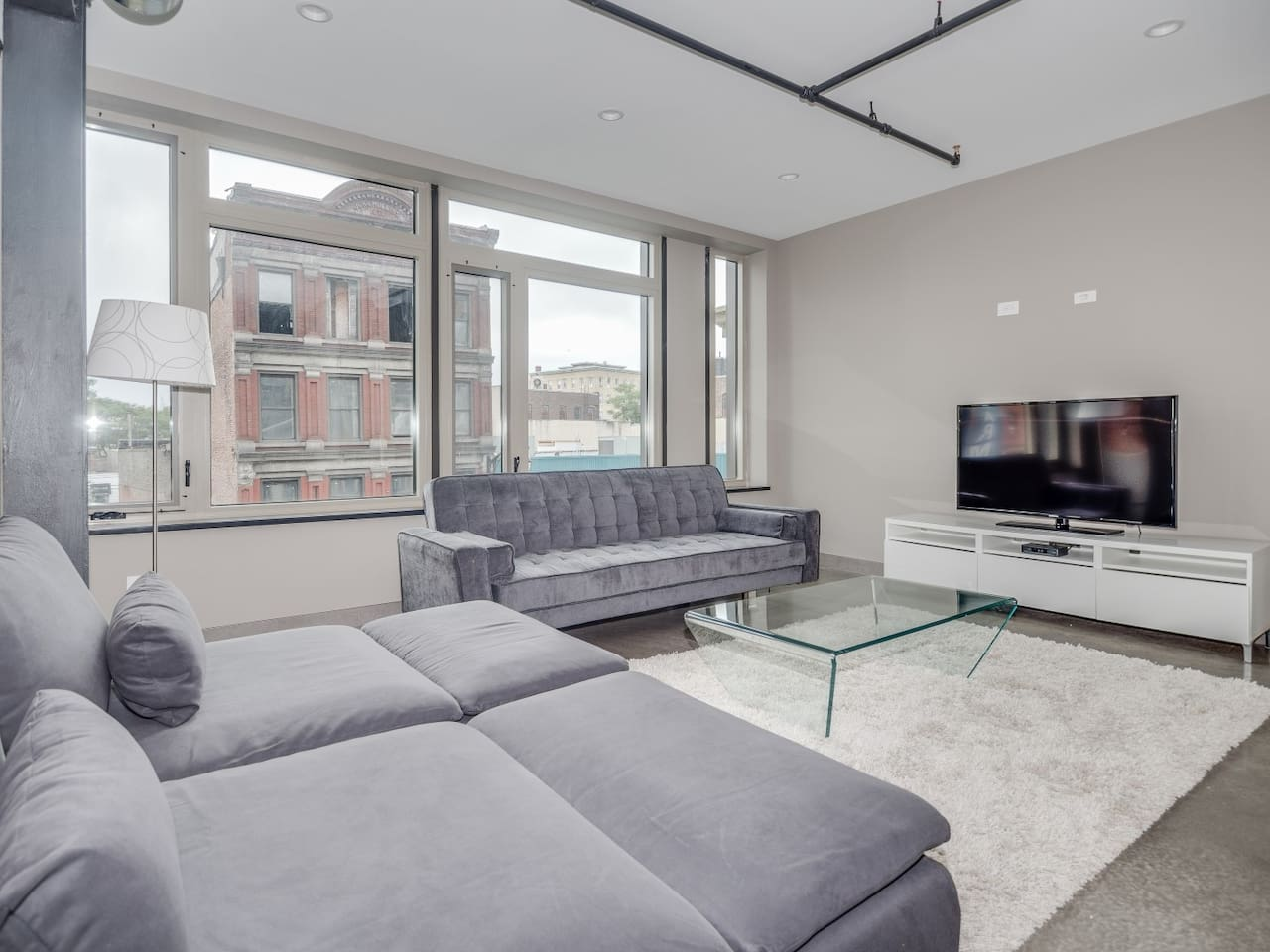 If you've always dreamed of living in a Soho loft, this 1,100 square-foot (102 square meters) two-bedroom apartment in the heart of Historic Downtown Jersey City is just as hip.