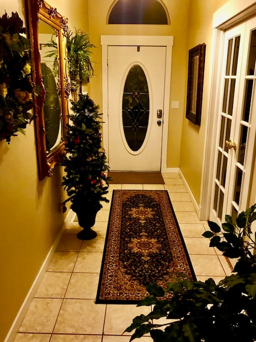 Entry way into  private downstairs Suite with private bedrooms and bathrooms