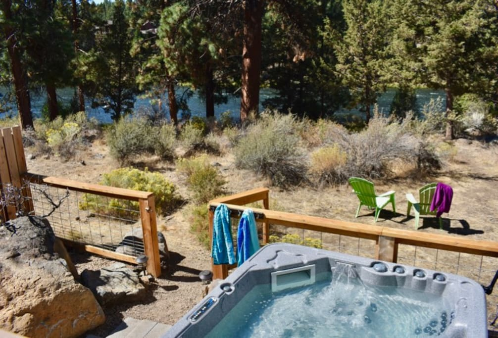 Soak in your own private hot tub or take a cold dip in the river.