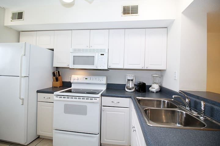 Modern kitchen equipped with all the necessary appliances and cookwares