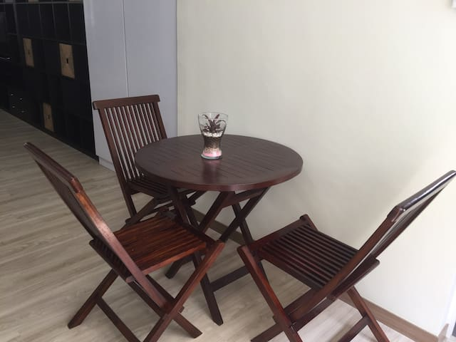 Teak wood dining table and chairs