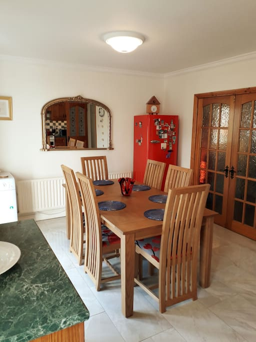 Large south facing full of light fitted kitchen opening out from double doors onto the garden. It has all the usual amenities including washing machine, dryer, dishwasher and microwave and bullit juicer