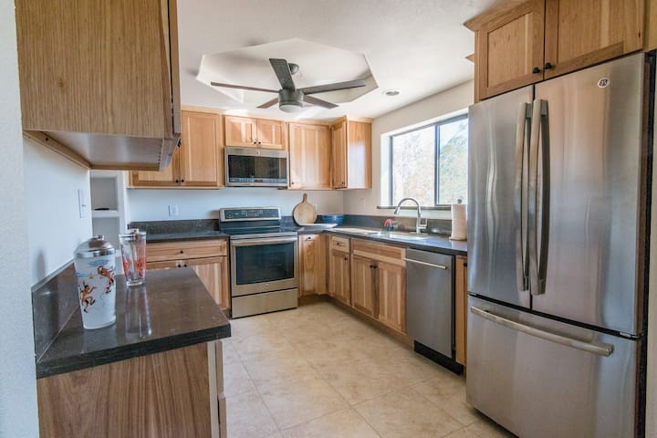 Nicely equipped kitchen with new appliances including microwave, cooktop and oven, dishwasher and spacious refrigerator with an ice maker in the pull out drawer freezer.
