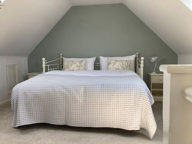 Top floor bedroom with super king size bed which can be split into 2 singles ( prior request) and private lockable hallway entrance