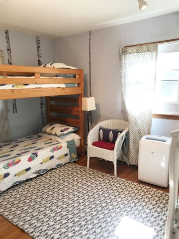 Bedroom 4: Bunk beds and a crib make this room perfect for sibling fun! A changing pad is available, too.