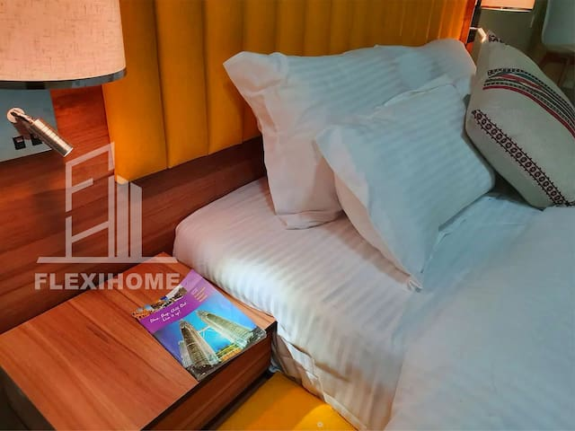 Comfy Queen Size Bed with Air Conditioning, Ceiling Fan and Side Table.