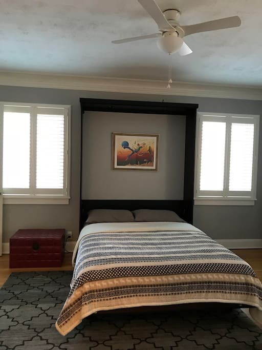 Queen size murphy bed and plenty of windows for natural lighting.