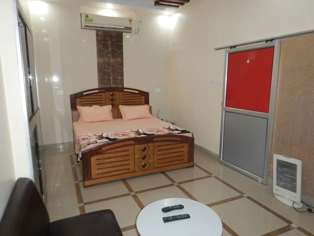 Furnished bedroom with kitchen and Free bike.