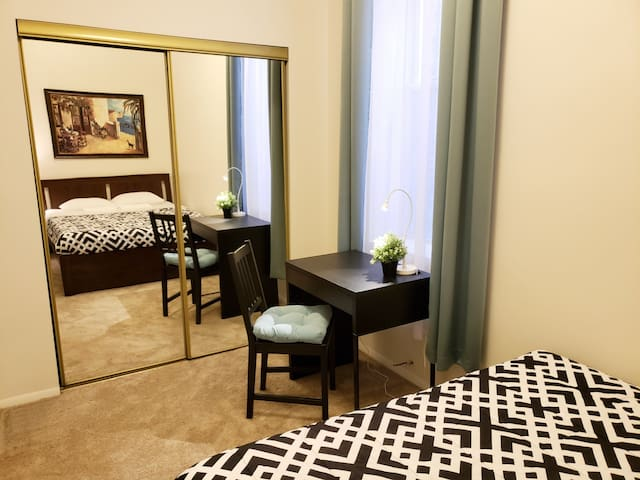 There is a desk and a full-sized mirror in your room!