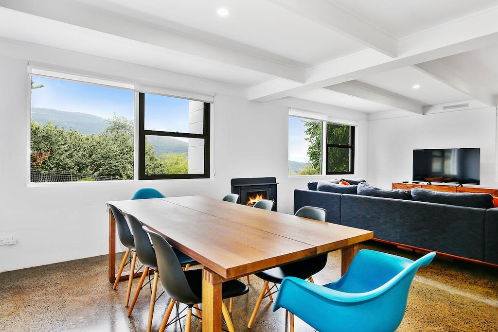 """Lounge room - hosting 8 seater dining table, L shaped sofa with 55"""" TV with Apple TV."""