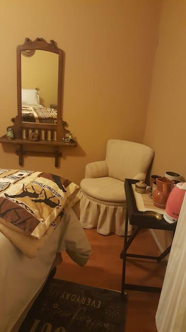 Mirror; tea/coffee facilities & resting arm chair